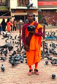 istock Buddhist monk in the central square of the city. 1296608301