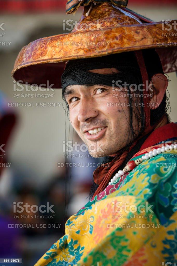 Buddhist monk in traditonal costume during monastery festival stock photo
