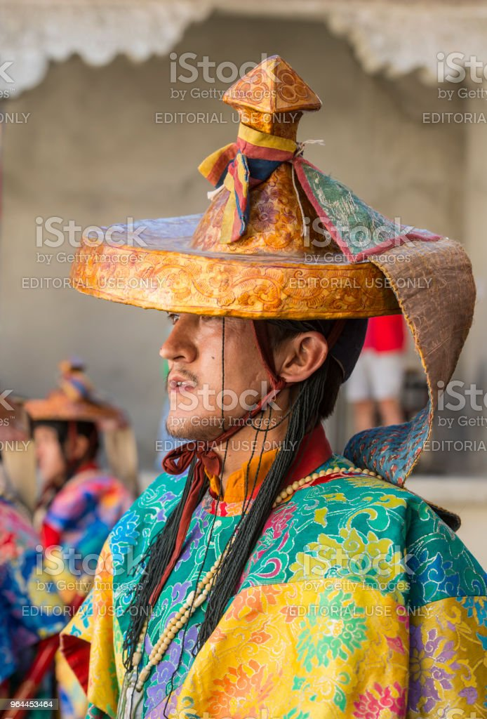 Buddhist monk in traditonal costume during monastery festival stock photo