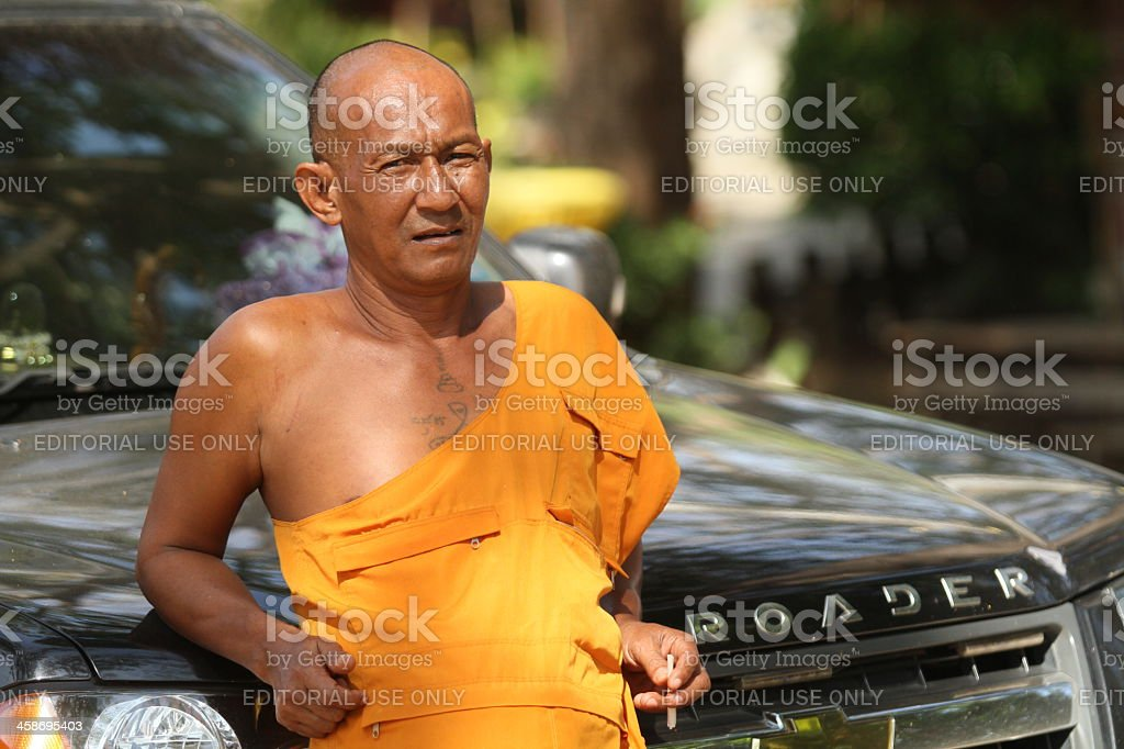 Buddhist monk near a car royalty-free stock photo