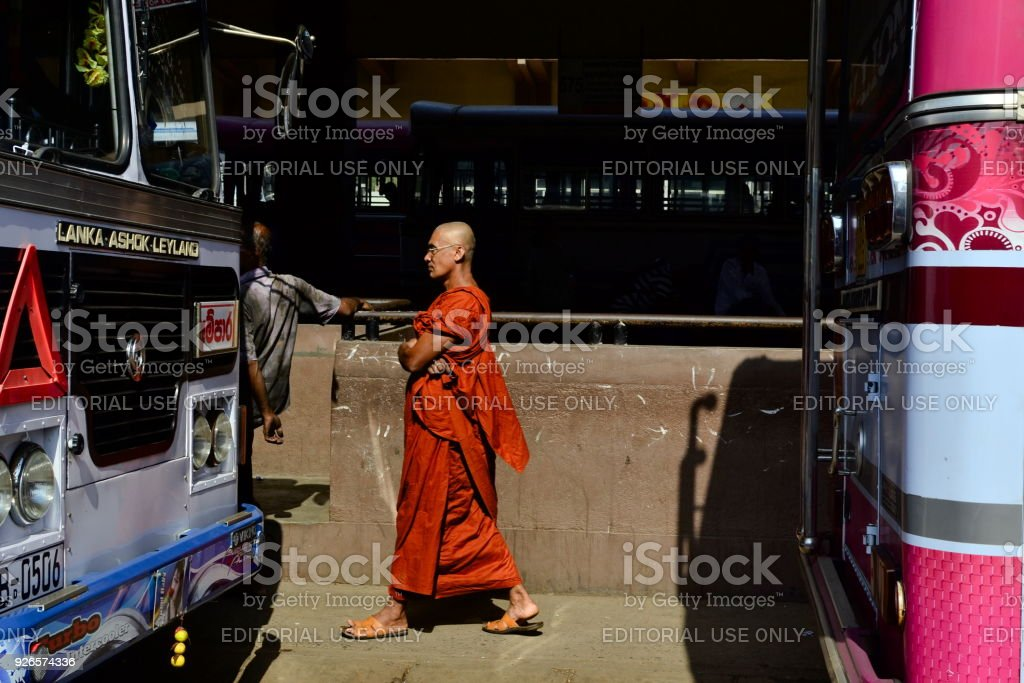 Buddhist monk on the bus station stock photo