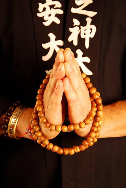 buddhist monk praying stock photo