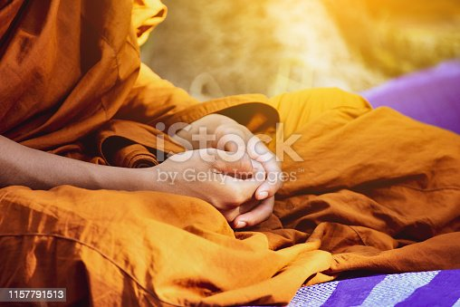 Buddhist monk vipassana meditate to calm the mind  in Thailand.