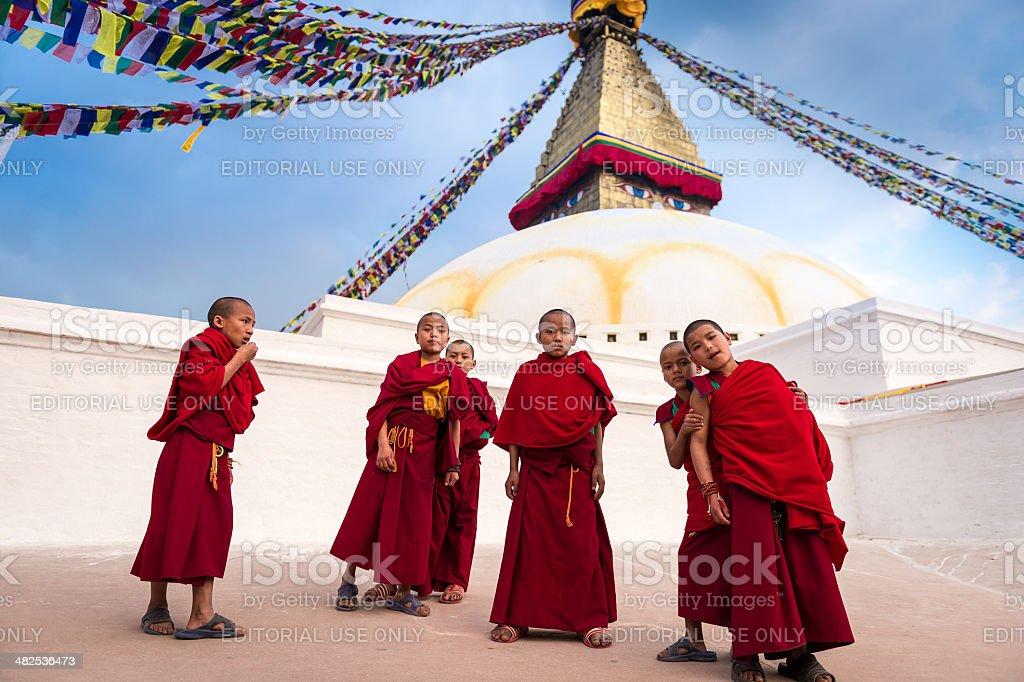 Buddhist monks at the stupa stock photo