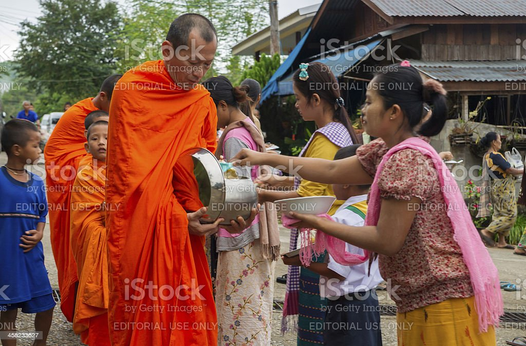 Buddhist monks at their morning almsround royalty-free stock photo