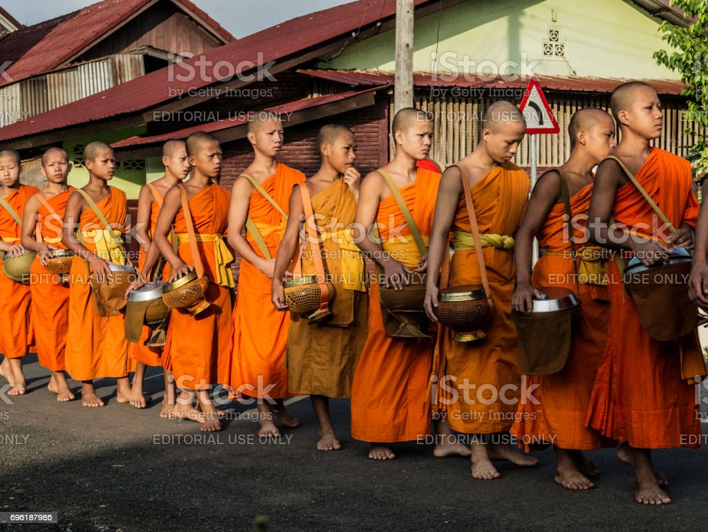 Buddhist monks collecting alms in Luang Prabang Laos stock photo