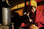 Sichuan Ganzi - November 30, 2015: Sichuan Lama reading at the Buddhist College, he is a teacher, with five students in this school.
