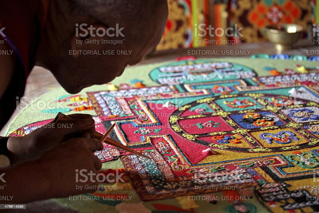 Buddhist monks making sand mandala stock photo
