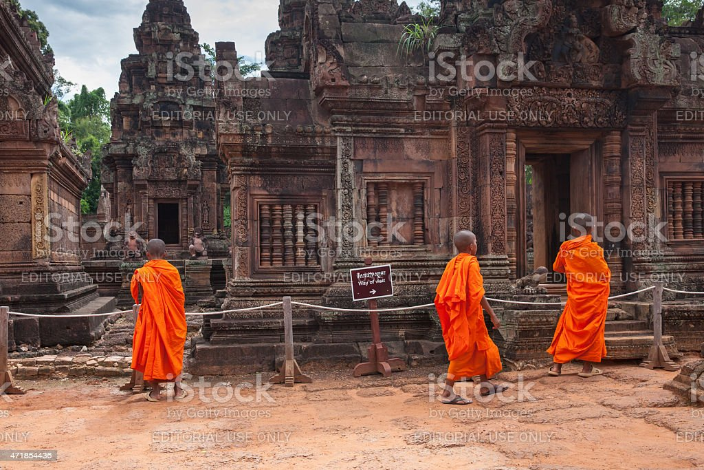Buddhist monks observing Banteay Srei Temple stock photo