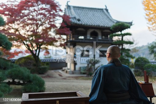Buddhist monks performing zen at autumn temple