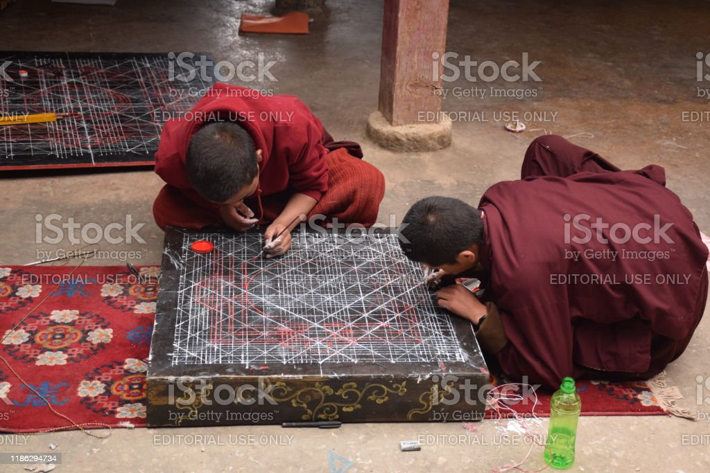Buddhist monks practicing drawing a mandala inside Sakya monastery, Tingri county, Tibet - China - Royalty-free Ancient Stock Photo