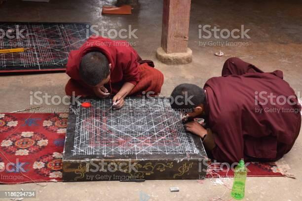 Buddhist Monks Practicing Drawing A Mandala Inside Sakya Monastery Tingri County Tibet China Stock Photo - Download Image Now