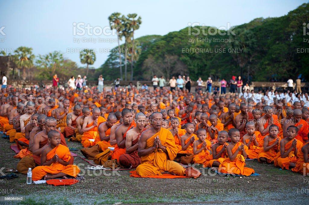 Buddhist monks praying in Angkor Wat stock photo