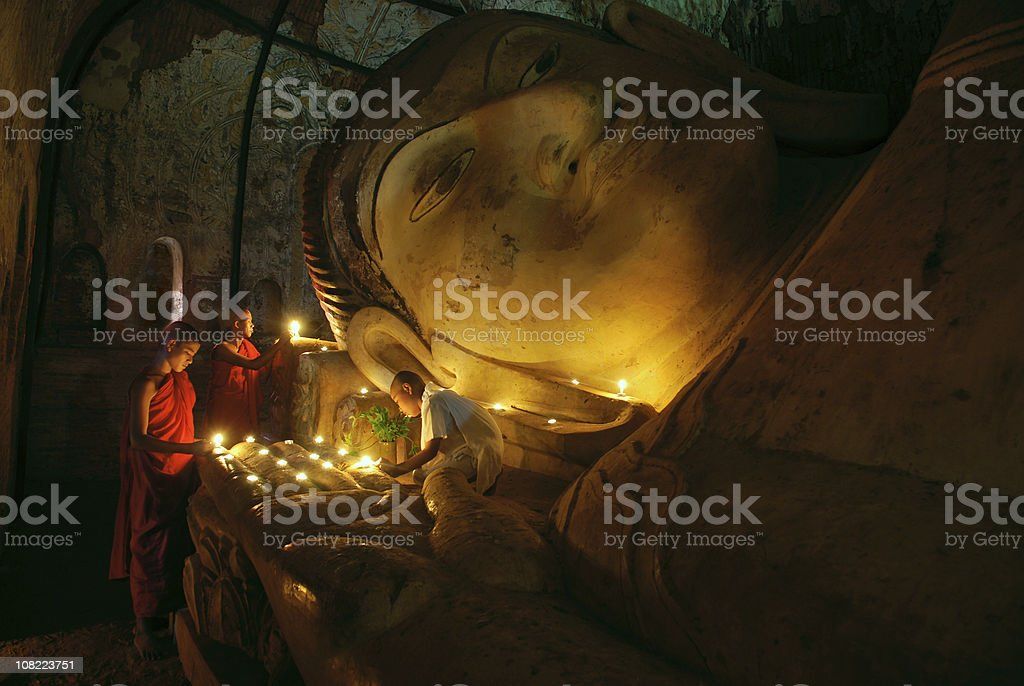 Buddhist monks praying in the temple stock photo