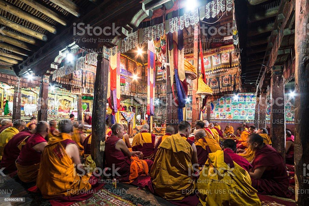 Buddhist monks praying in Thiksay monastery stock photo