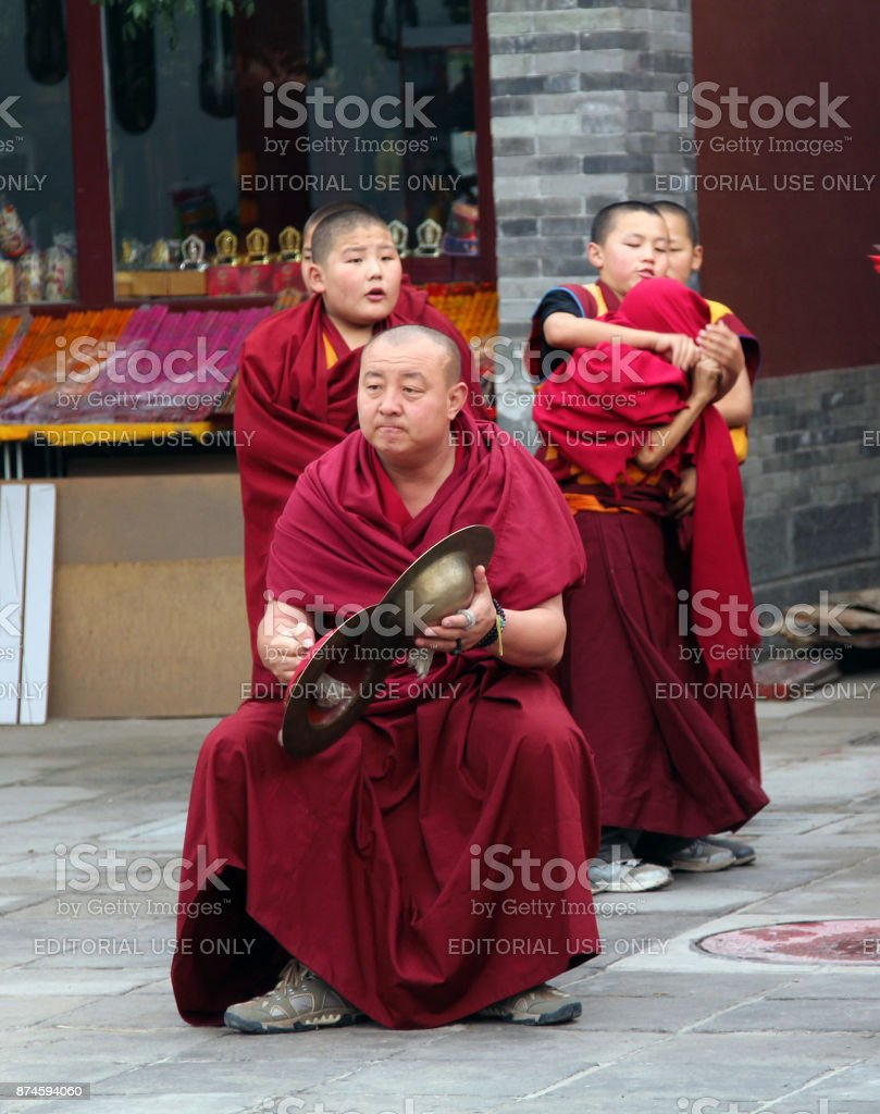 Buddhist monks preparing for the annual holiday presentation at the Dazhao Monastery, the largest Buddhist monastery of Hohhot, Inner Mongolia stock photo