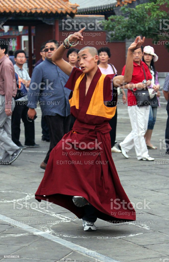 Buddhist monks rehearsing ritual dance in Dazhao Monastery, Hohhot, Inner Mongolia stock photo