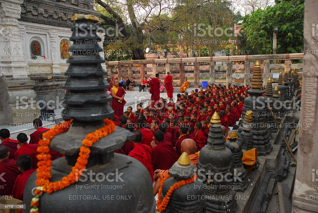 Buddhist monks sitting at the temple ground stock photo