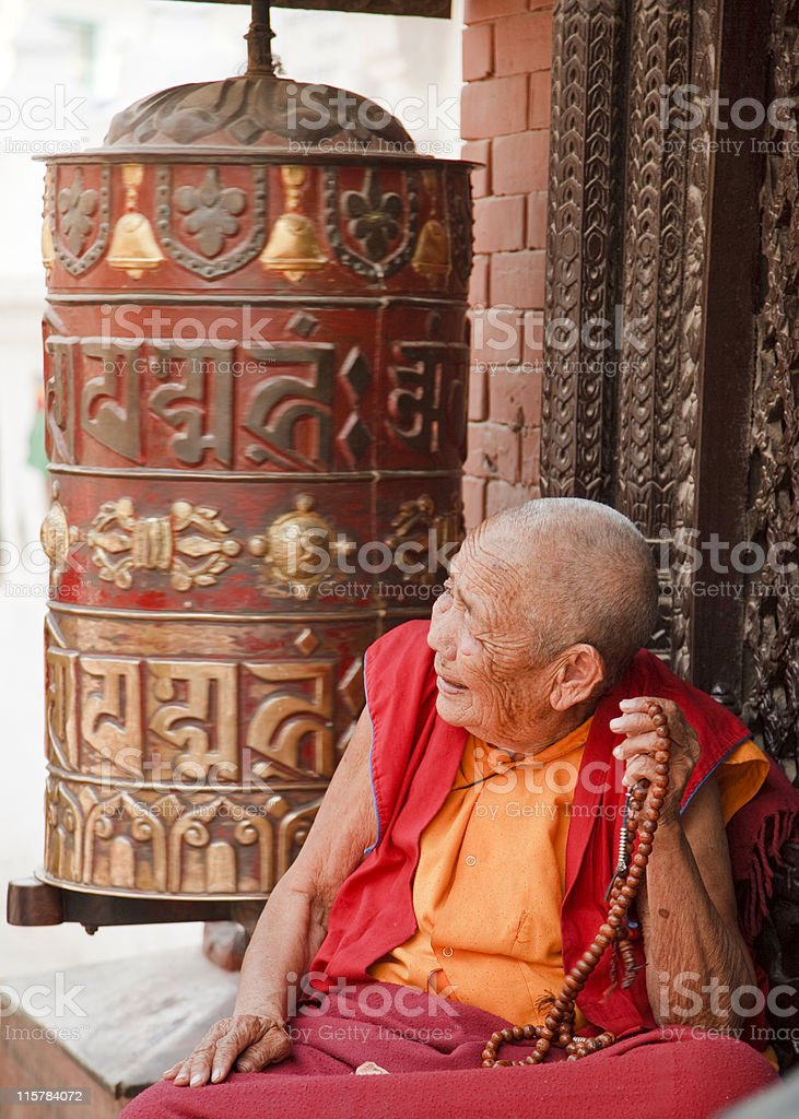 Buddhist Nun Prayer Wheel Mala royalty-free stock photo