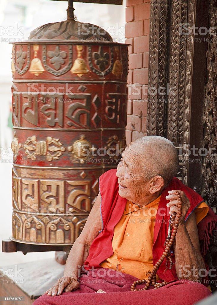 Buddhist Nun Prayer Wheel Mala stock photo