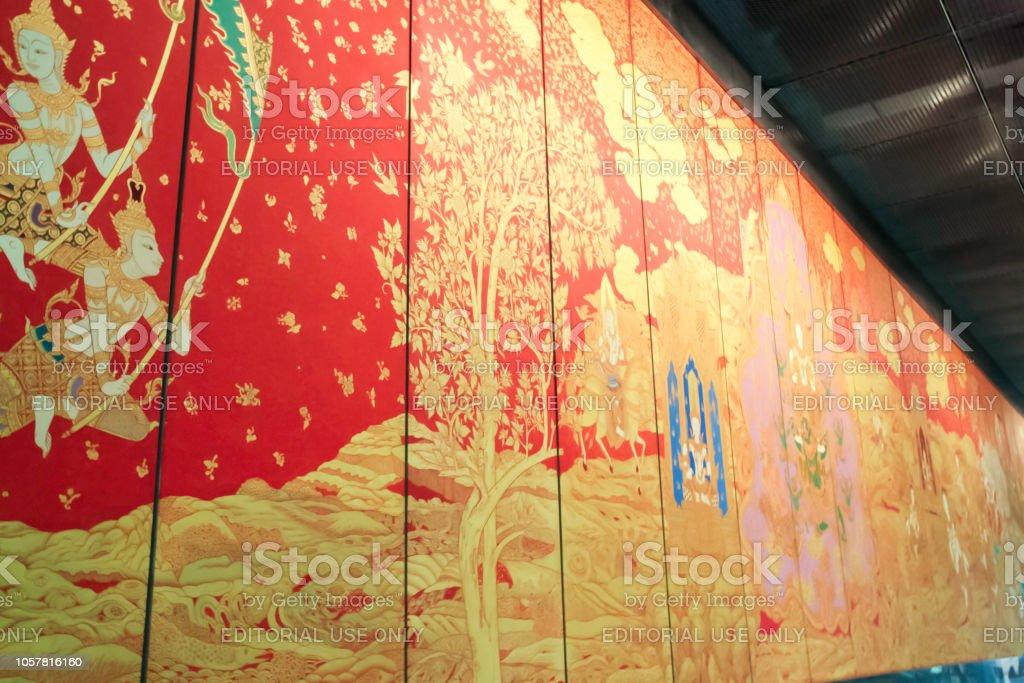 Bangkok - 2010: Buddhist painting in red and gold on wooden panels displayed at Bangkok International Airport stock photo