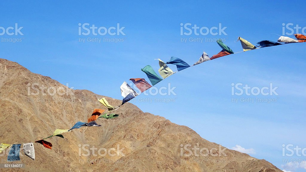 Buddhist Prayer Flags in the wind stock photo