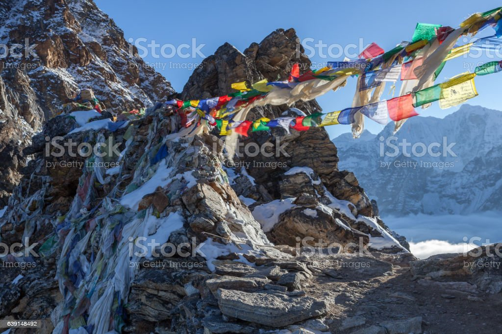 Buddhist prayer flags on Renjo La pass on Three Passes stock photo