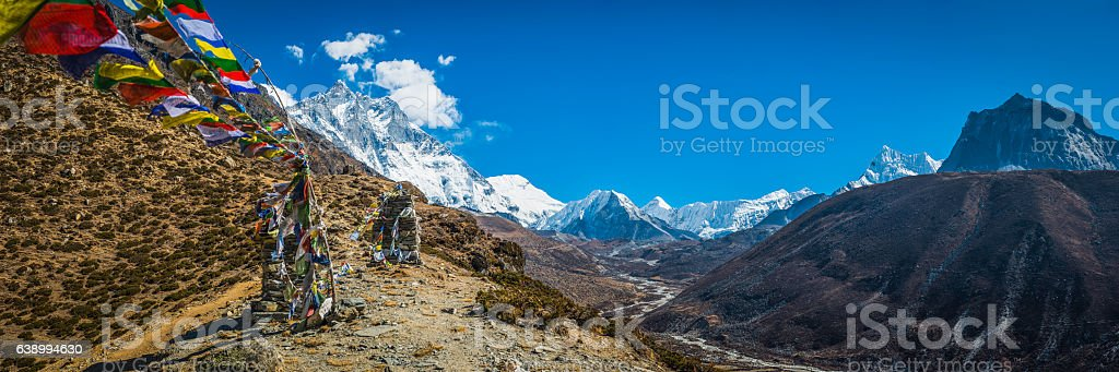 Buddhist prayer flags remote mountain valley Himalaya peaks panorama Nepal stock photo
