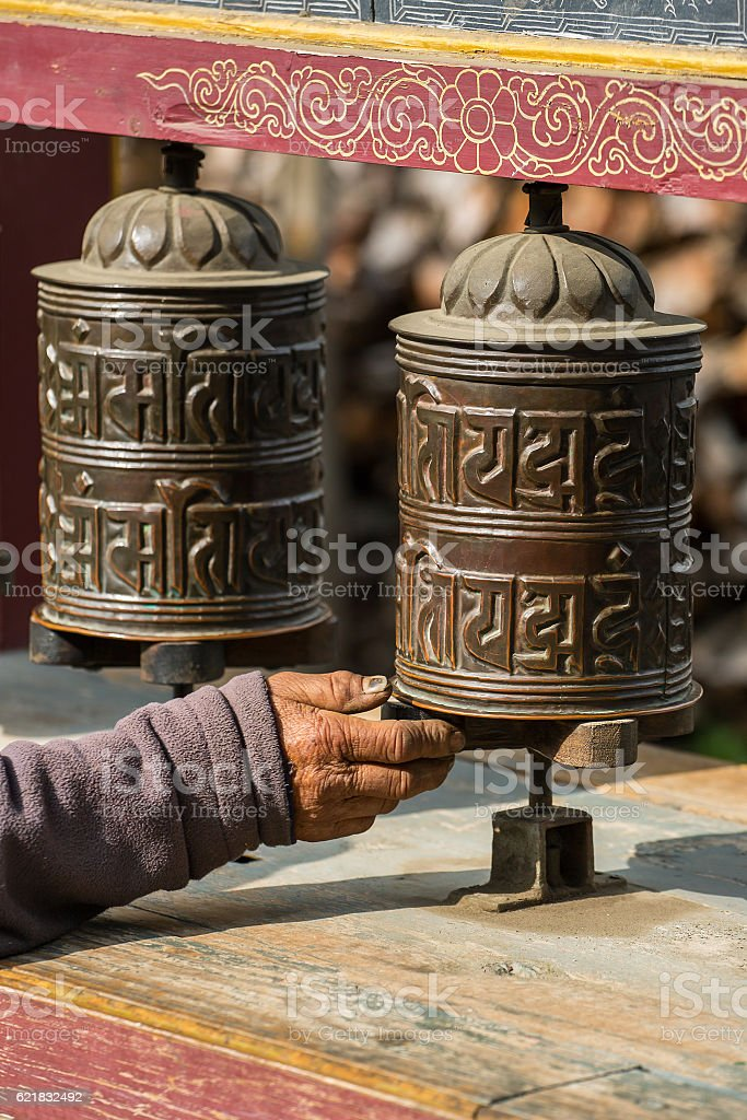 Buddhist prayer mani wall with prayer wheels stock photo
