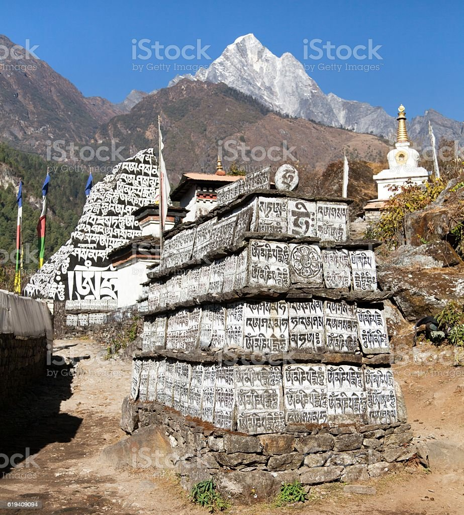 Buddhist prayer mani walls stock photo
