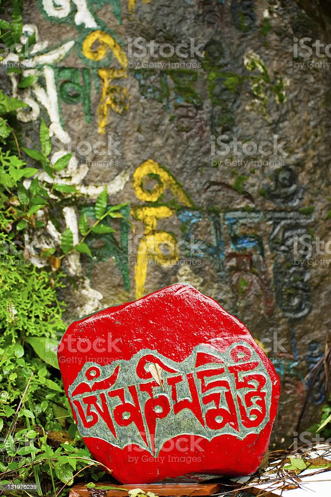 Buddhist prayer stone with mantra royalty-free stock photo