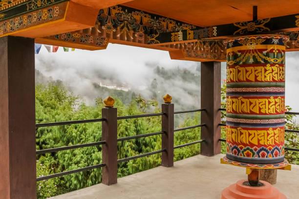 Buddhist prayer wheel in a temple in Bumthang, Bhutan stock photo