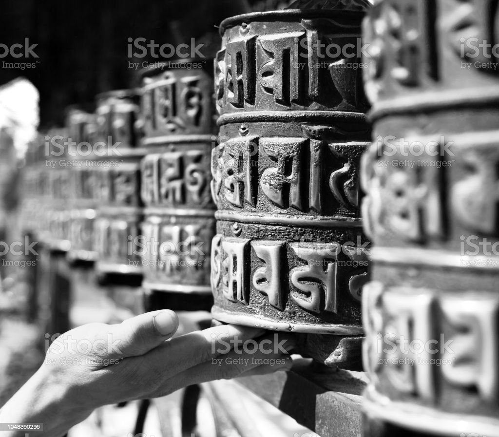 Buddhist Prayer Wheels And A Hand Stock Photo & More Pictures of