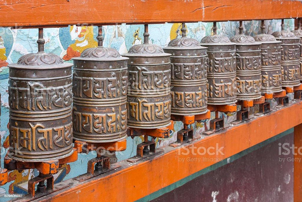 Buddhist Prayer Wheels at Boudhanath Stupa in Kathmandu Nepal stock photo