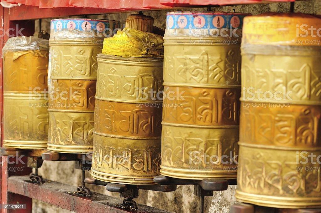 buddhist prayer wheels in potala palace,tibet ,china stock photo