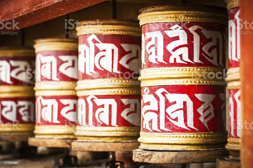 Buddhist prayer wheels in Tibetan monastery royalty-free stock photo