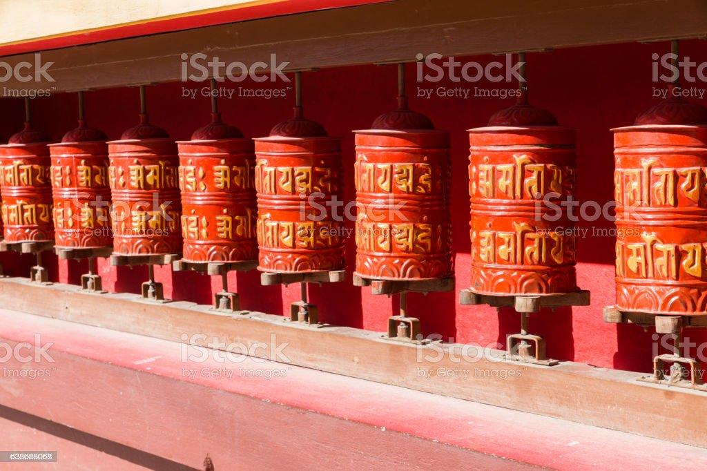Buddhist prayer wheels, Nepal. stock photo