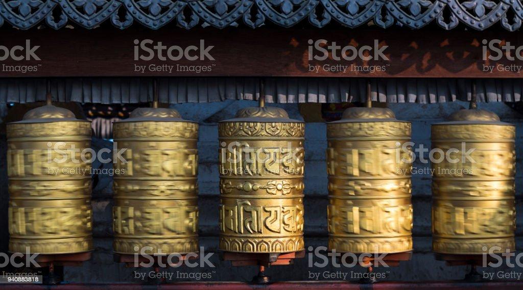 Buddhist prayer wheels rotating in motion. Kathmandu, Nepal stock photo
