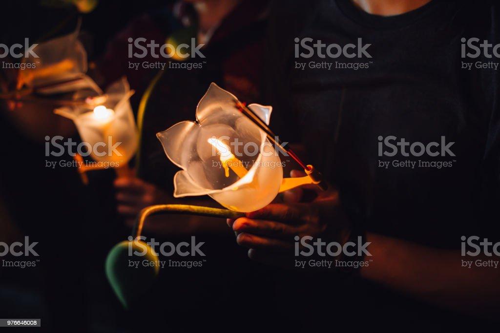 Buddhist praying with incense sticks lotus flower and candles on buddhist praying with incense sticks lotus flower and candles on holy religion day of vesak mightylinksfo