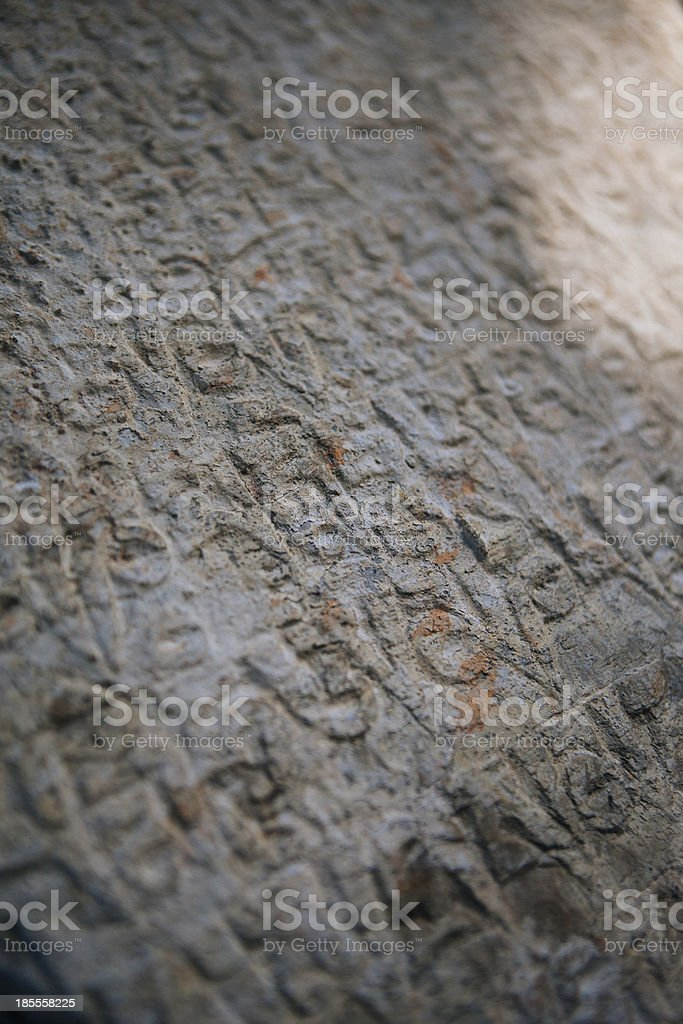 Buddhist scripture carved on a stone slab. royalty-free stock photo