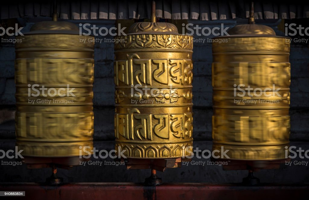 Buddhist shiny prayer wheels in motion. Nepal, Kathmandu stock photo