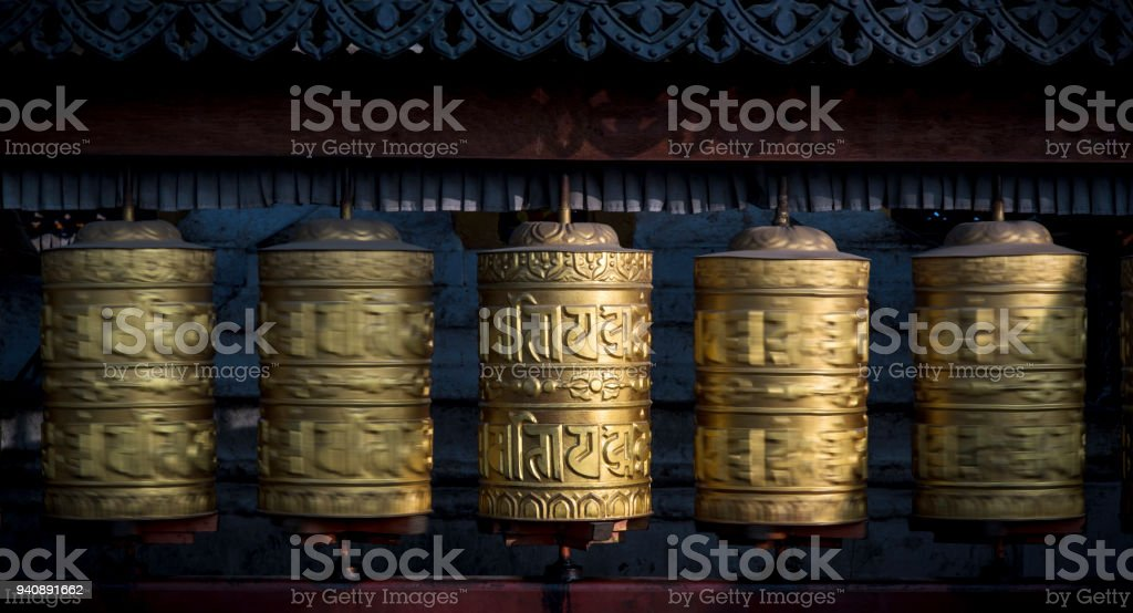 Buddhist shiny prayer wheels rotating in motion. Nepal, Kathmandu stock photo