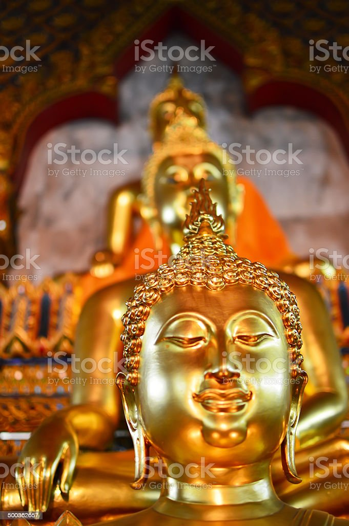 Buddhist statue at Wat Arun in Bangkok, Thailand stock photo