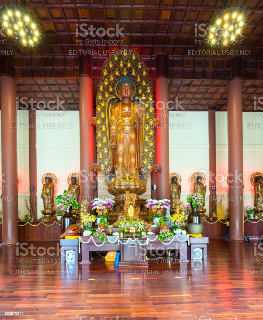 Buddhist statue in temple decorated lights, colorful flowers on Buddha's birthday stock photo