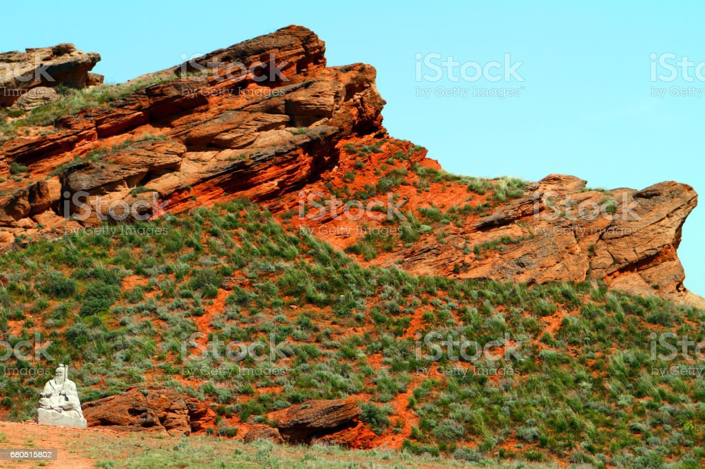 Buddhist statue of white wise man (white old man) at the red mountain stock photo