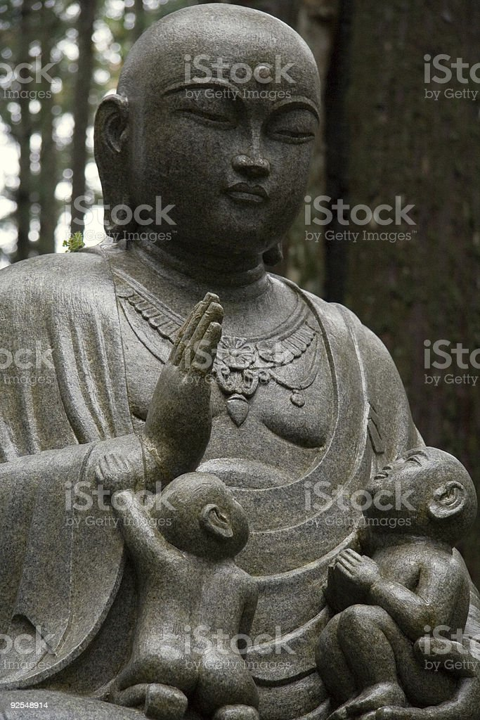 Buddhist Statue With Babies royalty-free stock photo