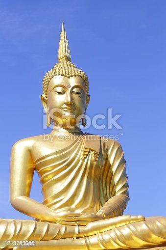 Buddhist statue with blue sky background