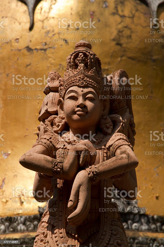 Buddhist statue with three faces stock photo