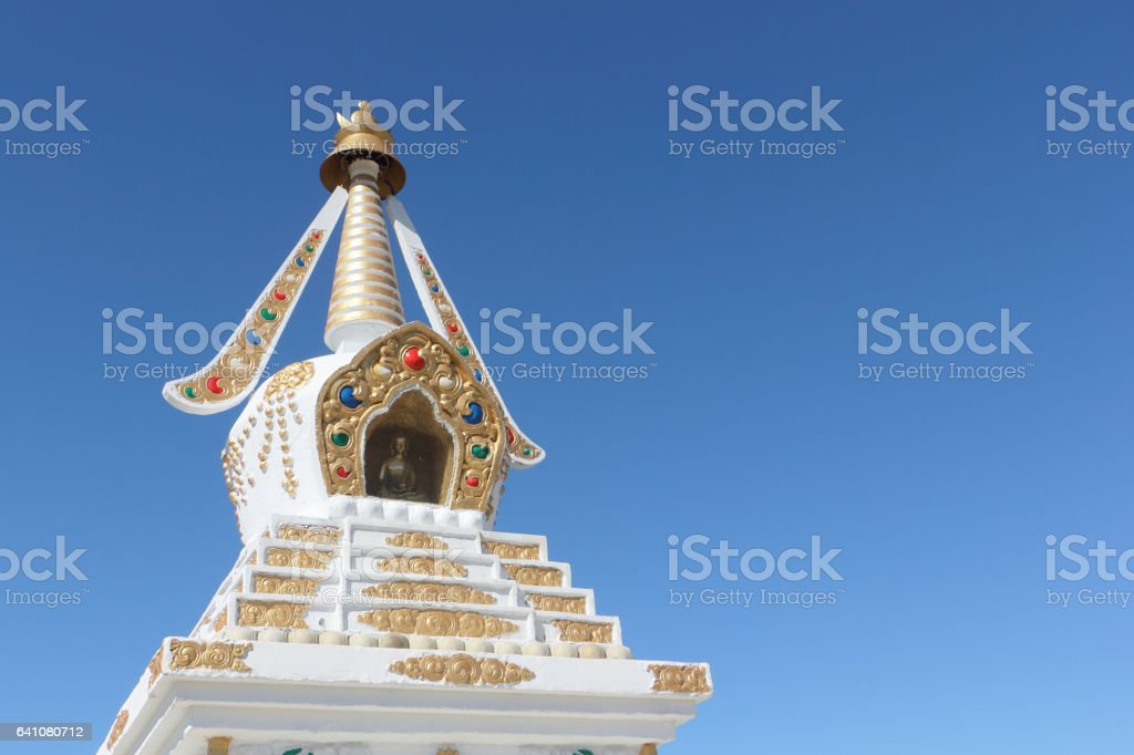 Buddhist stupa  against the background of the blue sky stock photo