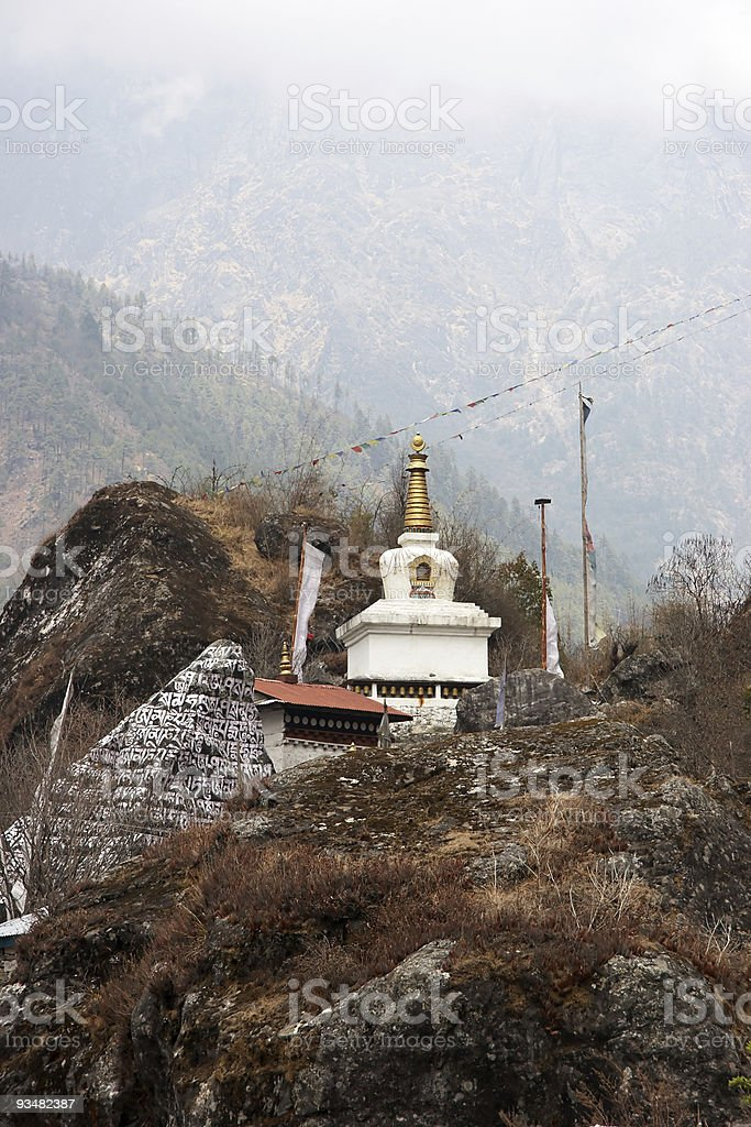 Buddhist stupa and prayer stone, Nepal royalty-free stock photo